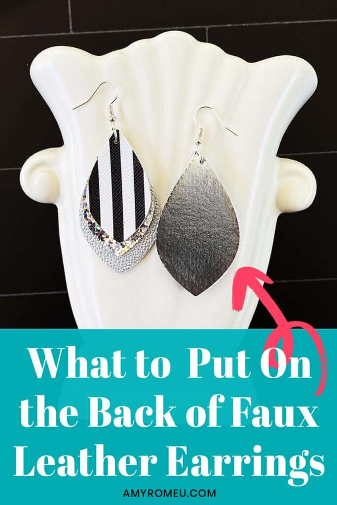 faux leather earrings on a white vase