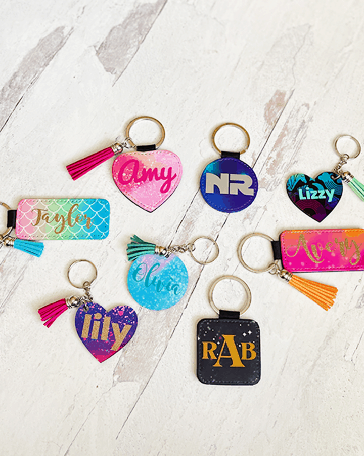 Collection of Personalized Keychains made with Cricut Infusible Ink