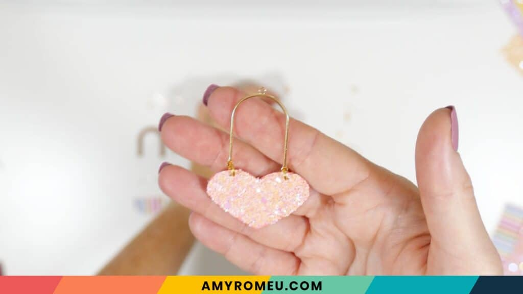 arch connector earrings with a faux leather heart