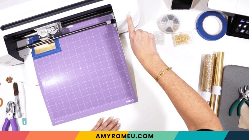 loading purple cutting mat into Cricut cutting machine