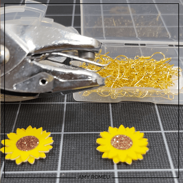 sunflower earrings made with a hole punch