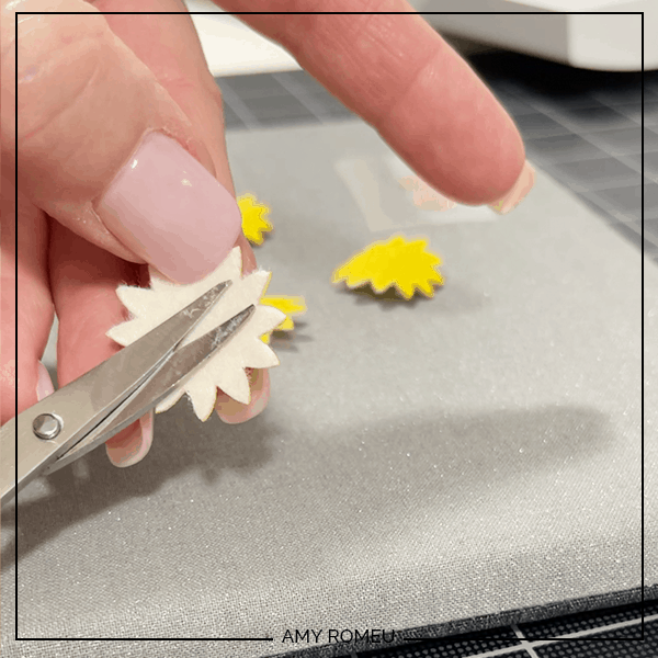trimming back of faux leather sunflower earrings