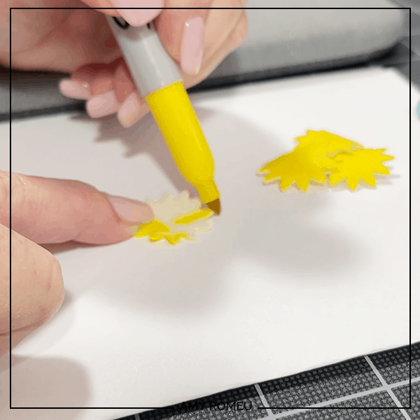 coloring sunflower petals with a Sharpie