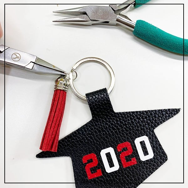 using pliers to attach a tassel to a keyring