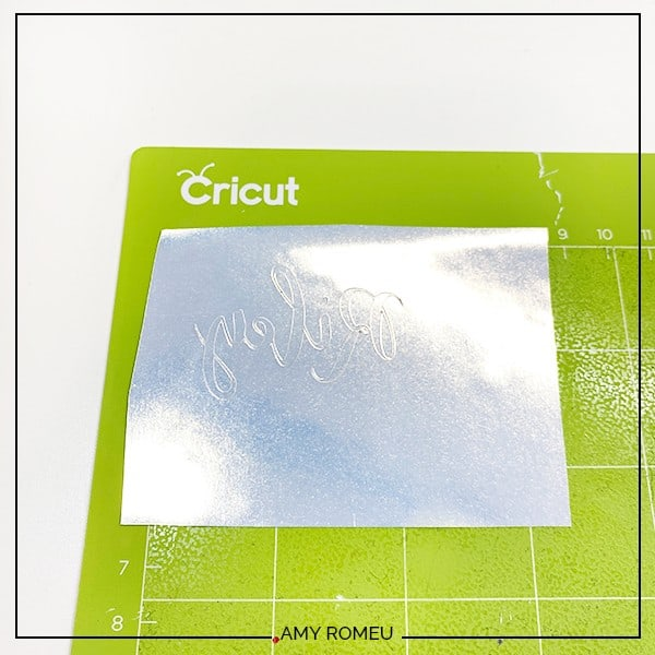 cut foil iron on placed on a green Cricut cutting mat