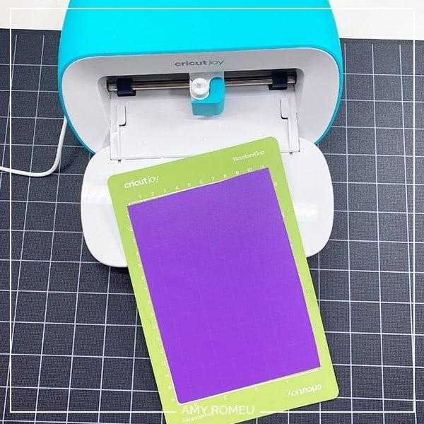 placing plastic sheet on cricut joy cutting mat for ear savers tutorial