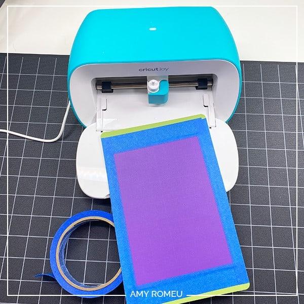 tape plastic to cricut joy mat for ear saver tutorial
