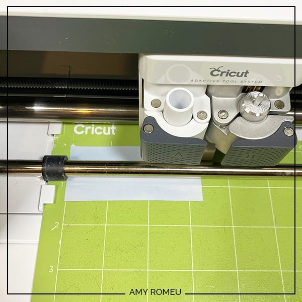 foil iron on on green cutting mat loaded into Cricut Maker