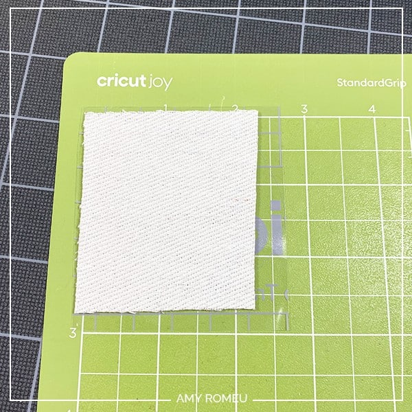 cricut joy cutting faux leather for earrings on green joy mat