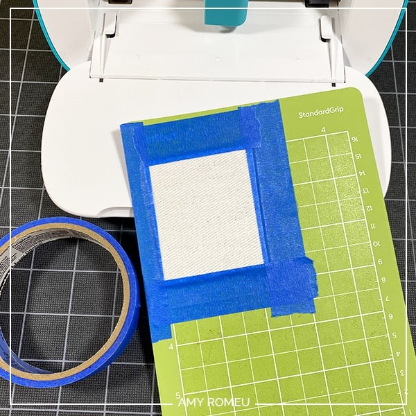 taping faux leather to cricut joy mat to make earrings