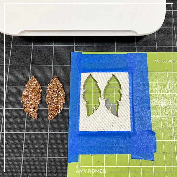 glitter feather faux leather earring shapes removed from a Cricut Joy cutting mat
