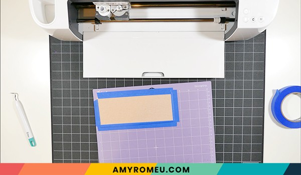 taping faux leather down to purple Cricut cutting mat