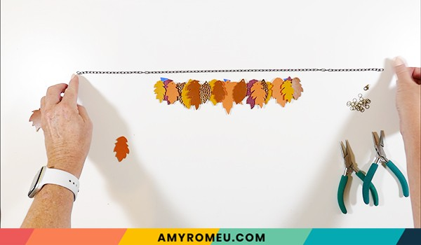 faux leather fall leaves necklace laid out
