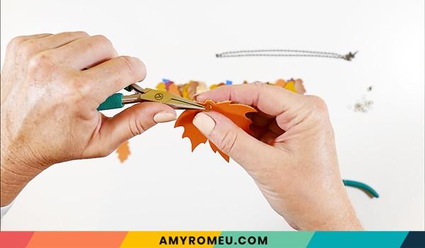 attaching jump ring to faux leather leaf necklace