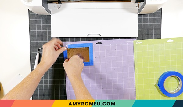 taping down faux leather to purple Cricut cutting mat