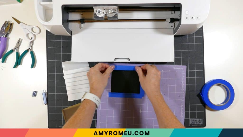 taping faux leather down to purple Cricut mat
