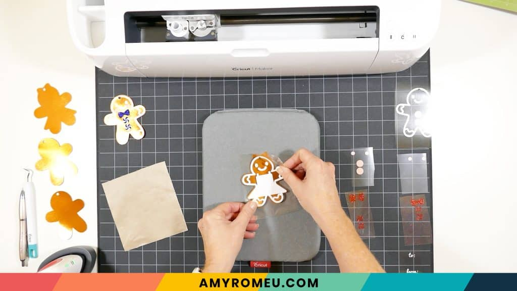 pressing vinyl layer on gingerbread girl