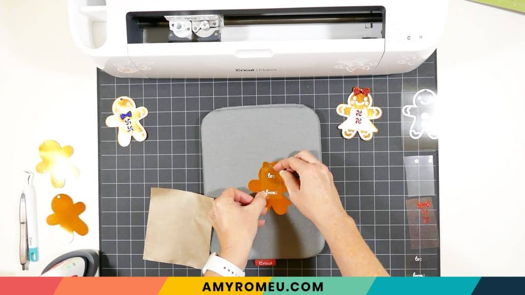 gift tag text heat pressed to a gingerbread man shape