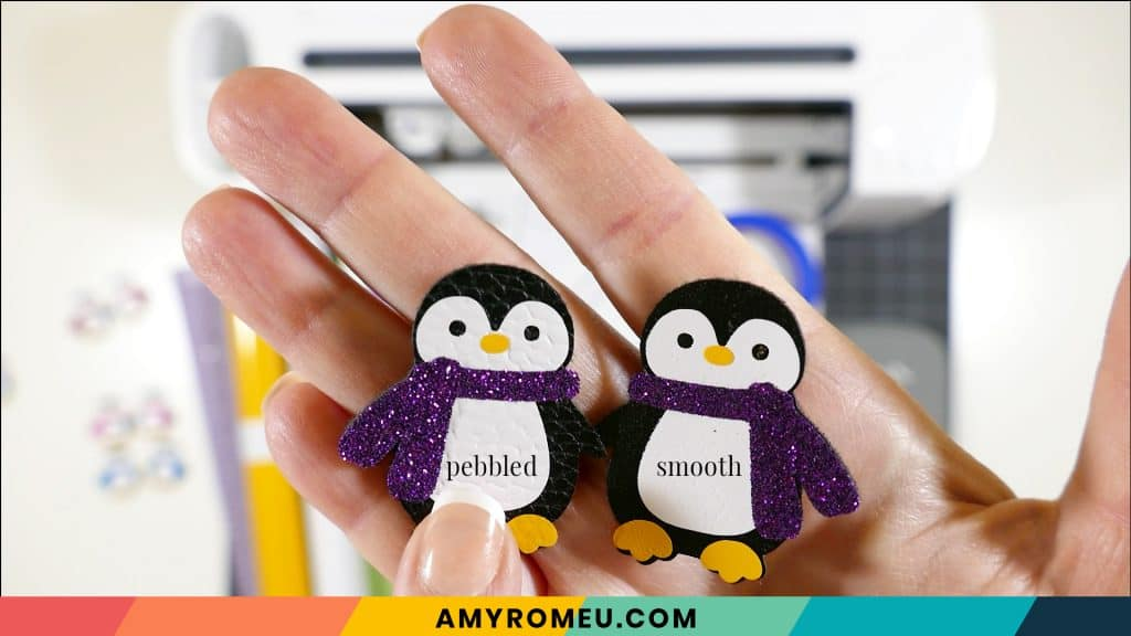 penguin earrings made with smooth and pebbled faux leather