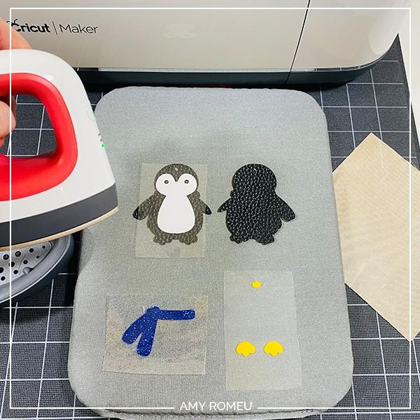heat pressing vinyl layers on penguin keychain