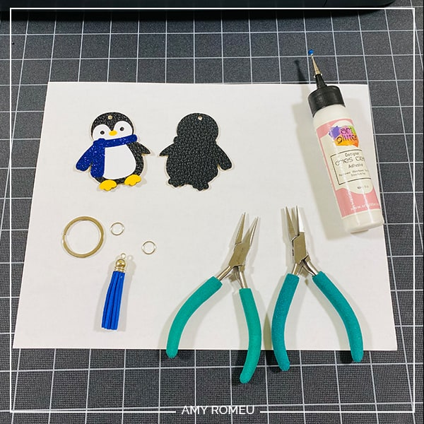 gluing penguin keychain together