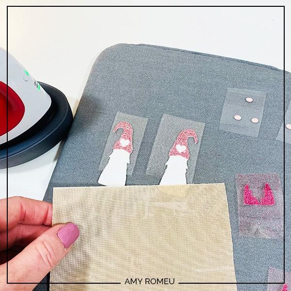 heat pressing valentine's day gnome earrings with Cricut easy press mini