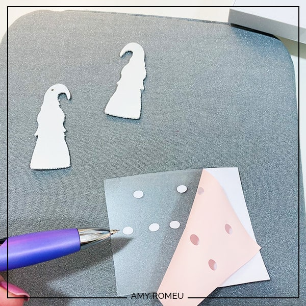cutting and weeding heat transfer vinyl for gnome earrings