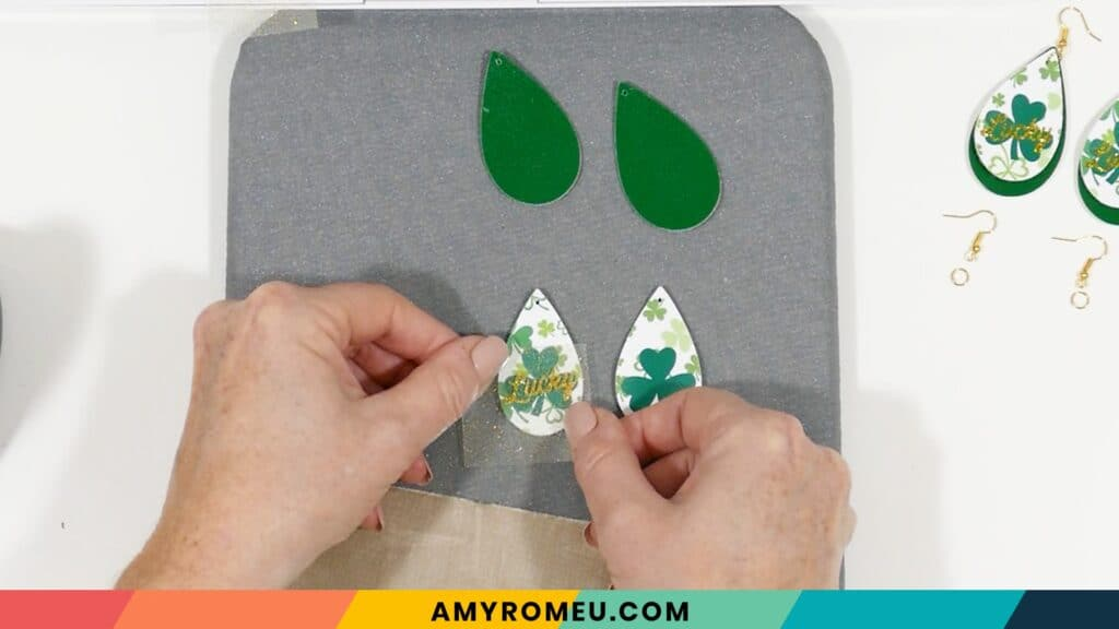second pressing of heat transfer vinyl on St. Patrick's Day faux leather earrings