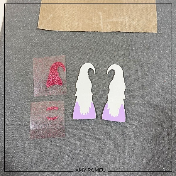 pressing layers of heat transfer vinyl for easter gnome earrings
