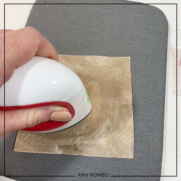 pressing gnome earrings with a Cricut easy press mini