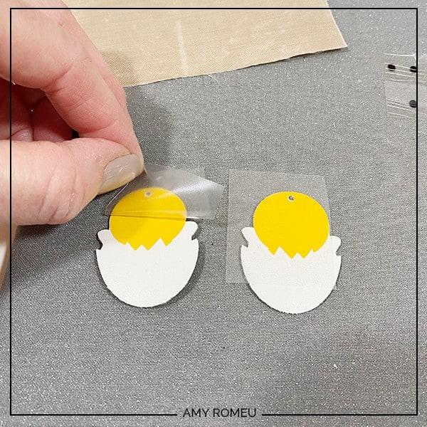 peeling vinyl cover sheet from Easter Chick earrings