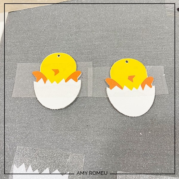 pressing Easter chick earring layers