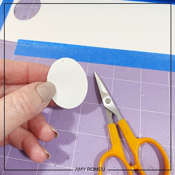 trimming earring shapes with scissors
