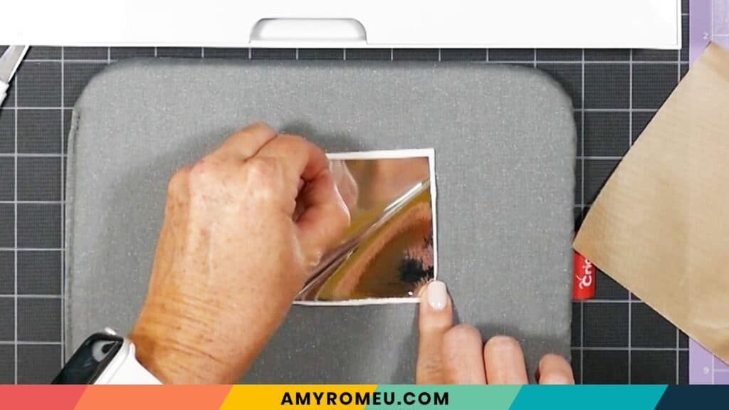 removing carrier sheet from vinyl pressed onto faux leather