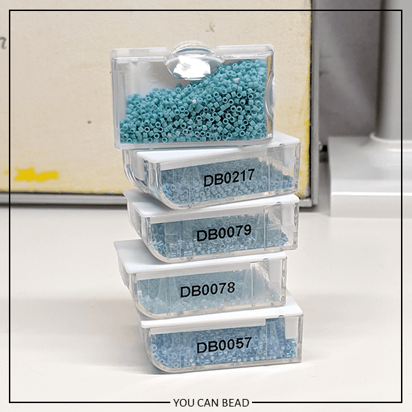 close up of labeled bead storage containers