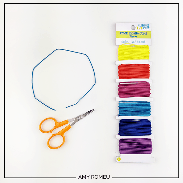 elastic cord and scissors for beaded bracelet tutorial