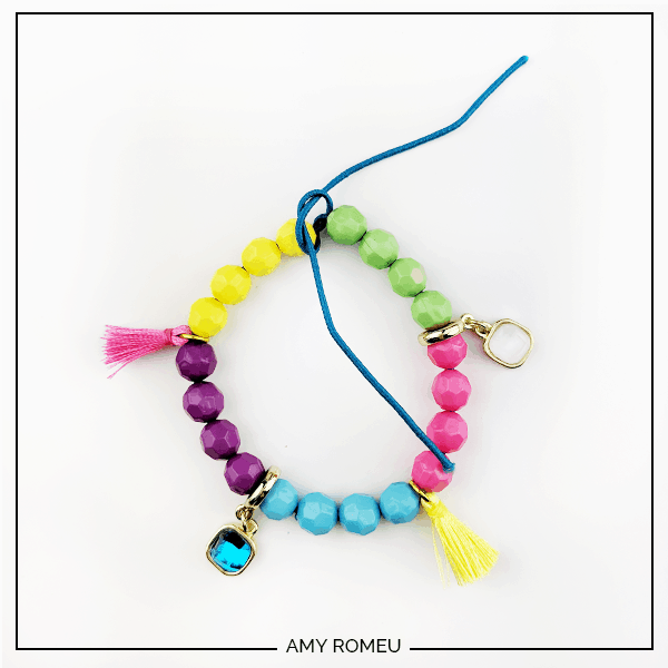 stack bracelet with beads, charms, and tassels on elastic bead cord
