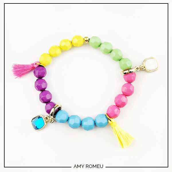 DIY stack bracelet made with beads, tassels and charms