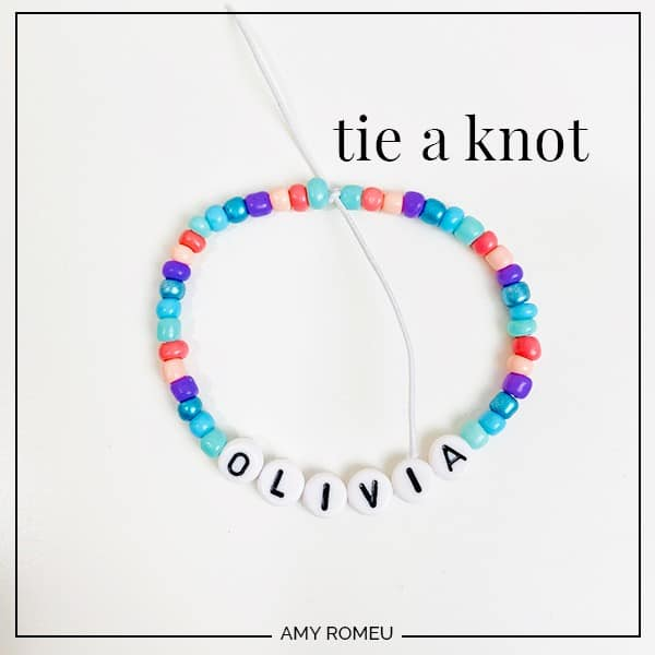 stretchy bracelet with letter beads tied in a knot