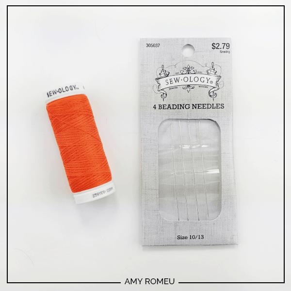 orange thread and beading needles