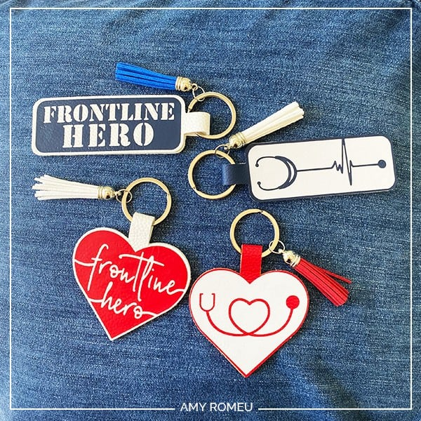 faux leather keychains with the words frontline hero and a stethoscope graphic