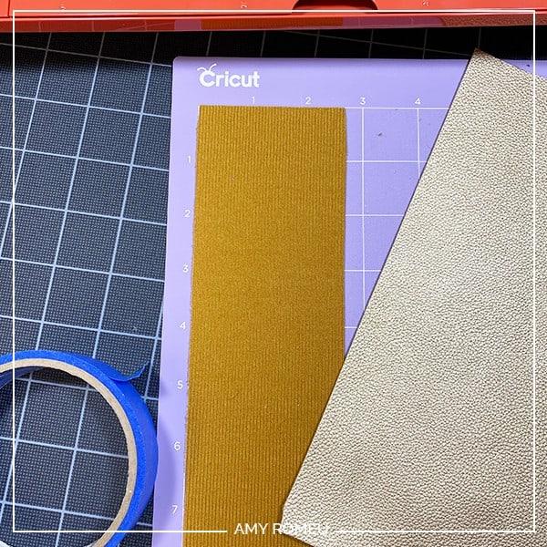 faux leather placed on a purple cricut mat