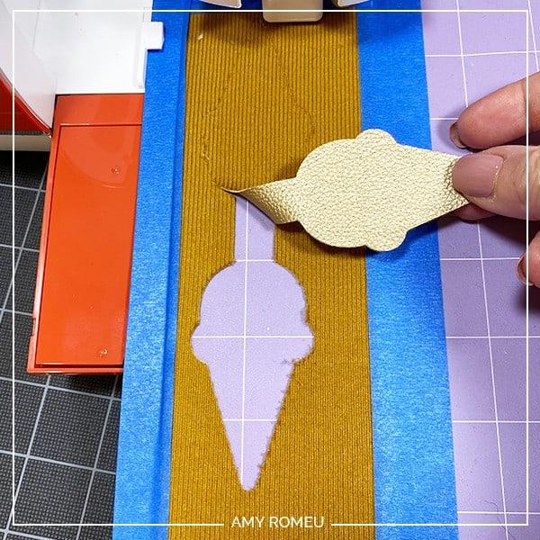 checking faux leather cut on a purple cricut mat