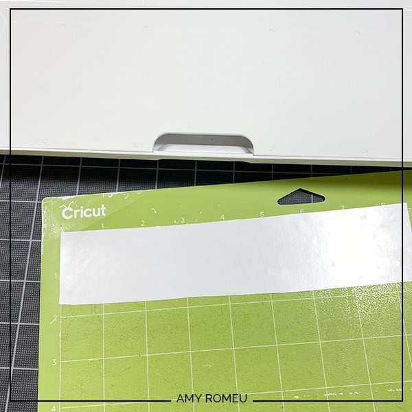 cutting white HTV on green Cricut cutting mat