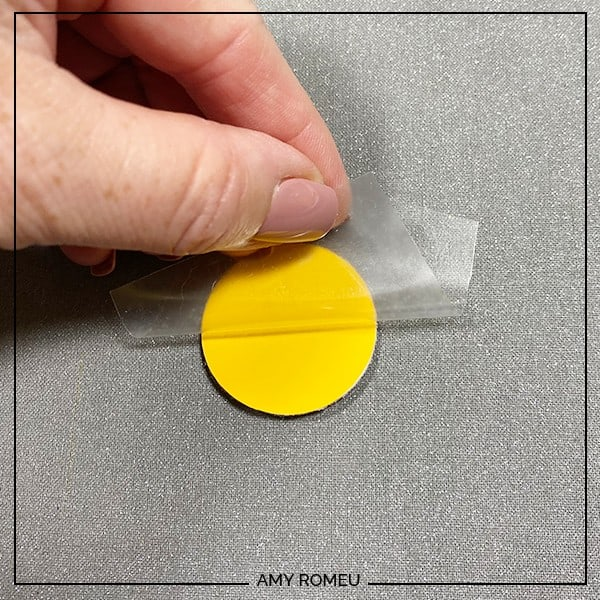 peeling vinyl cover sheet away from HTV