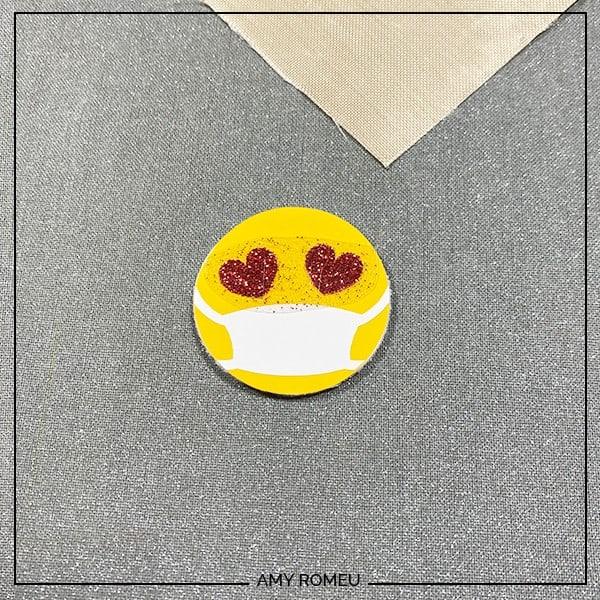 pressing red glitter vinyl heart eyes on emoji face