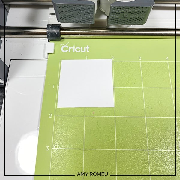 white HTV on a green Cricut cutting mat