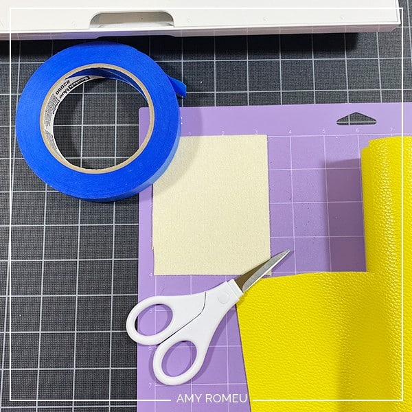 placing faux leather on purple mat for cutting