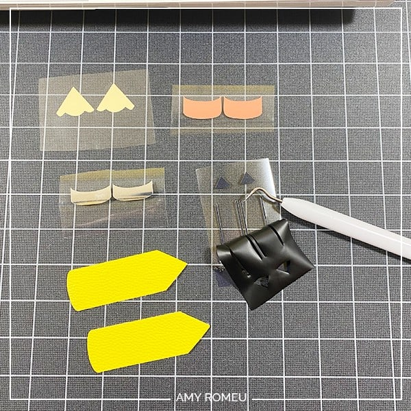 weeded heat transfer vinyl and faux leather pencil keychain shapes