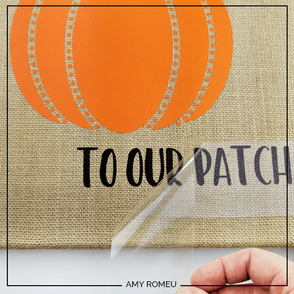 pressing HTV text on a burlap canvas fall decor project